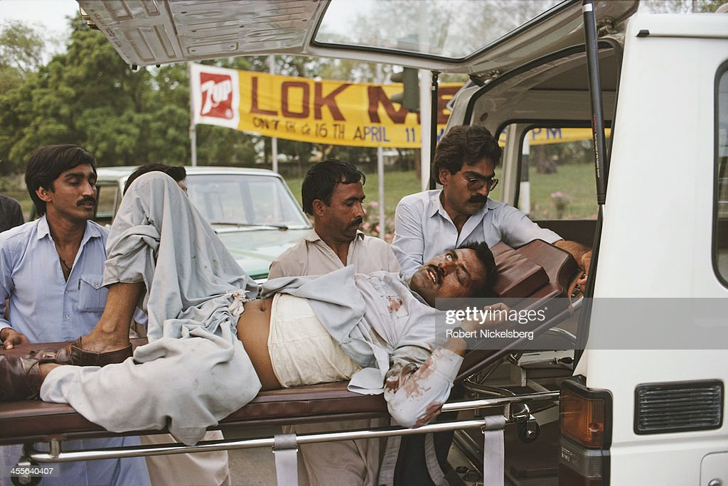 A man injured during the Ojhri Camp explosion is carried on a stretcher after the blast Rawalpindi Pakistan April 1988