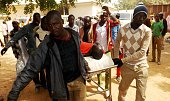 A man injured in a suicide blast is transported at the General Hospital in northeast Nigerian town of Potiskum on January 12 2015 Four people were...