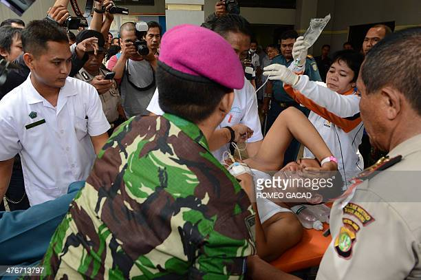A man injured in an Indonesian navy ammunition blast is brought to a navy hospital in Jakarta on March 5 2014 One naval serviceman was killed and 71...