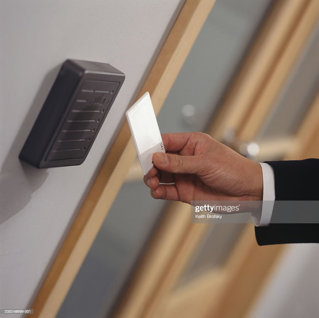 Man inserting card key into card reader, Close-up of hand, (Close-up)