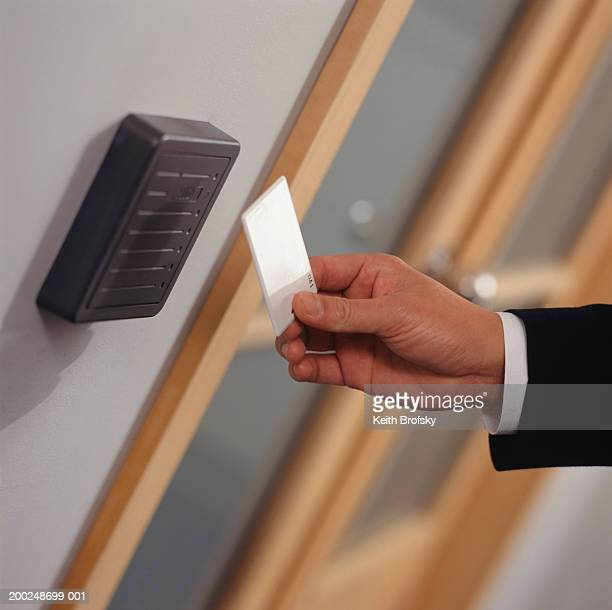 Man inserting card key into card reader, Close-up of hand, (Close-up)