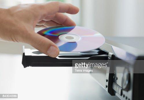 Man inserting dvd