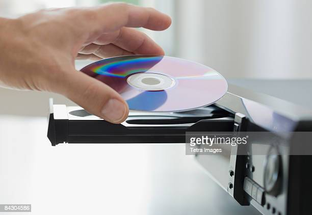 Man inserting dvd