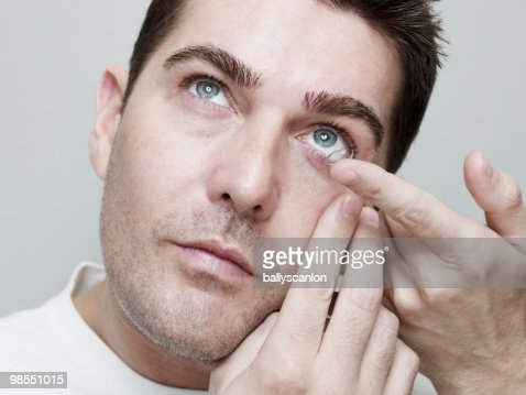 Man Inserting/Guiding Contact Lenses. : Stock Photo