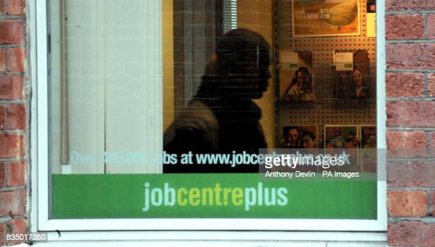 A man inside a Job Centre Plus in Westminster London as record numbers of people are being made redundant and job vacancies are falling as...