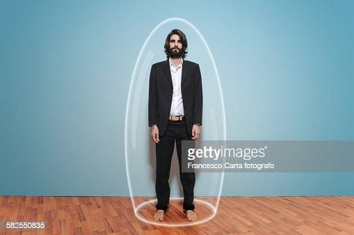 Man inside a large glass test tube
