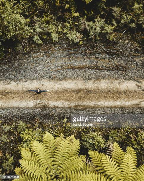 man inside the yarra ranges forest piloting a drone