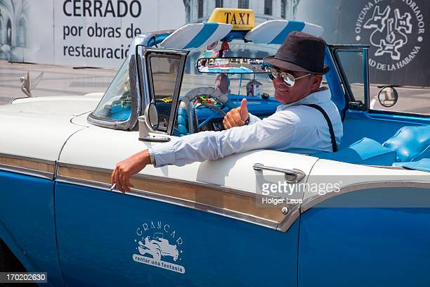 Man inside vintage convertible car taxi