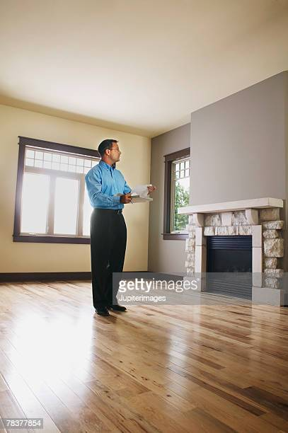 Man inspecting house interior