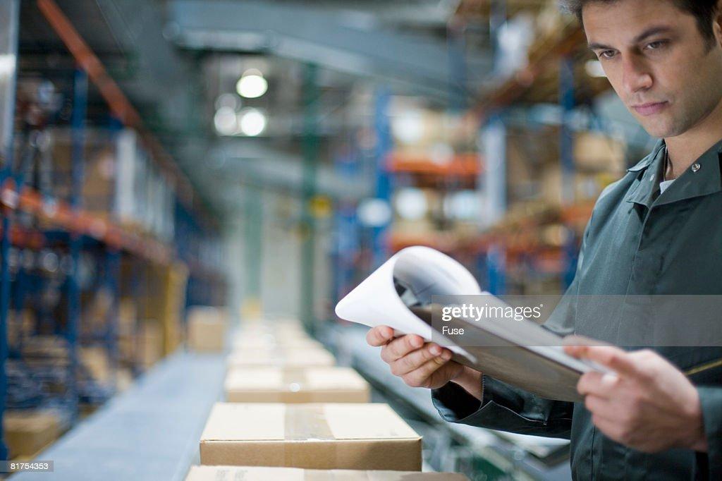 Man Inspecting Warehouse