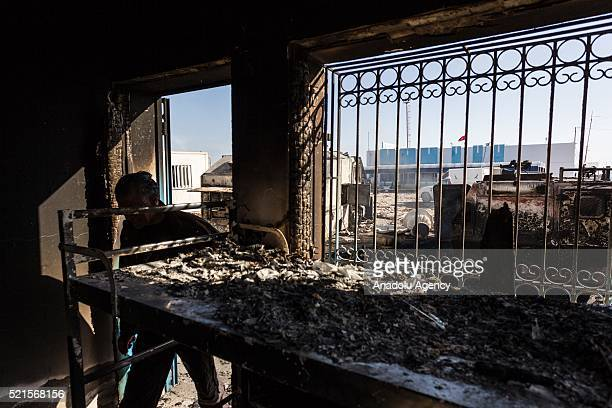 A man inspects a building damaged during clashes between a group of demonstrators protesting against oil tankers try to reach Petrofac Oil company's...