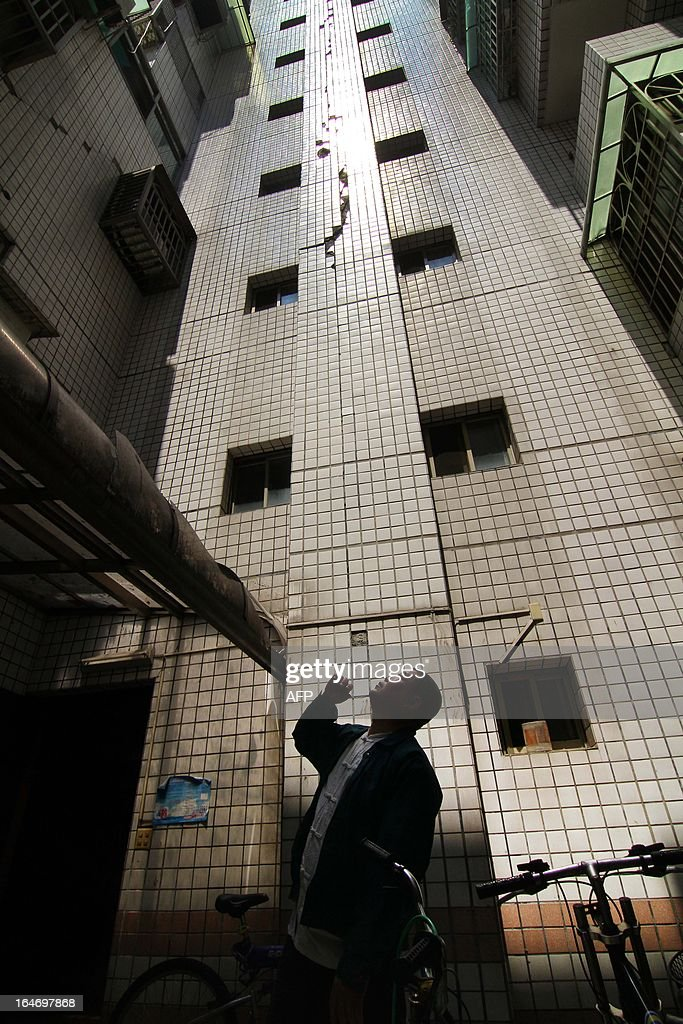 A man inspects a damaged building in Dali district, central Taichung city, on March 27, 2013. A strong earthquake shook buildings in the Taiwanese capital Taipei, injuring at least 20 people and sparking a fire, emergency officials said.