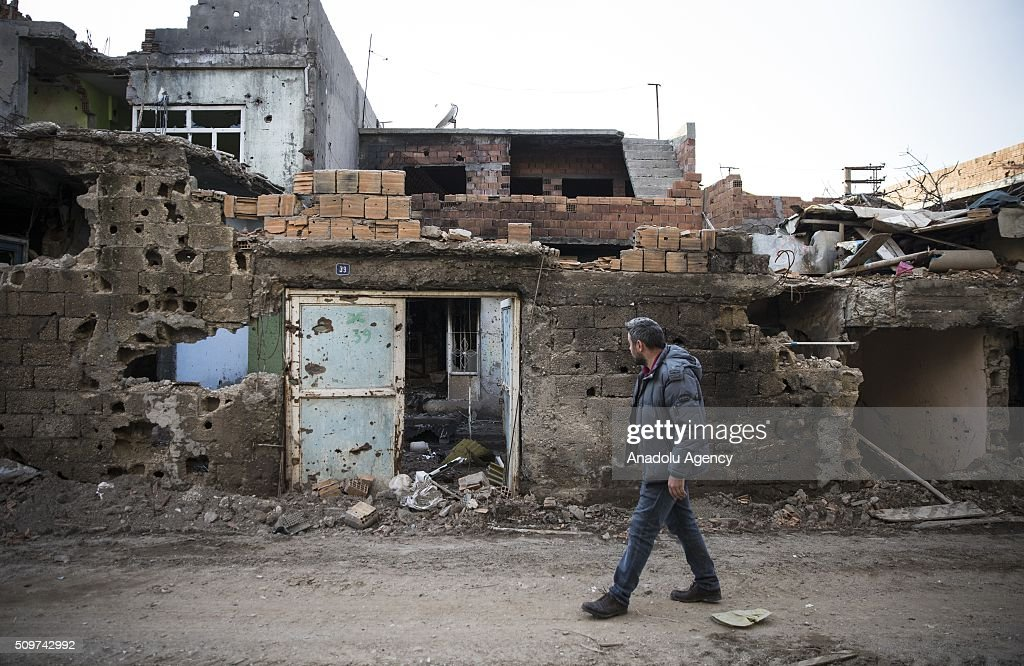 A man inspects a street where PKK heavily damaged whole neighborhood, after counter-terror operation in Cizre, the southeastern Turkish town that has seen fighting rage between security forces and PKK terrorists finished, on February 12, 2016.