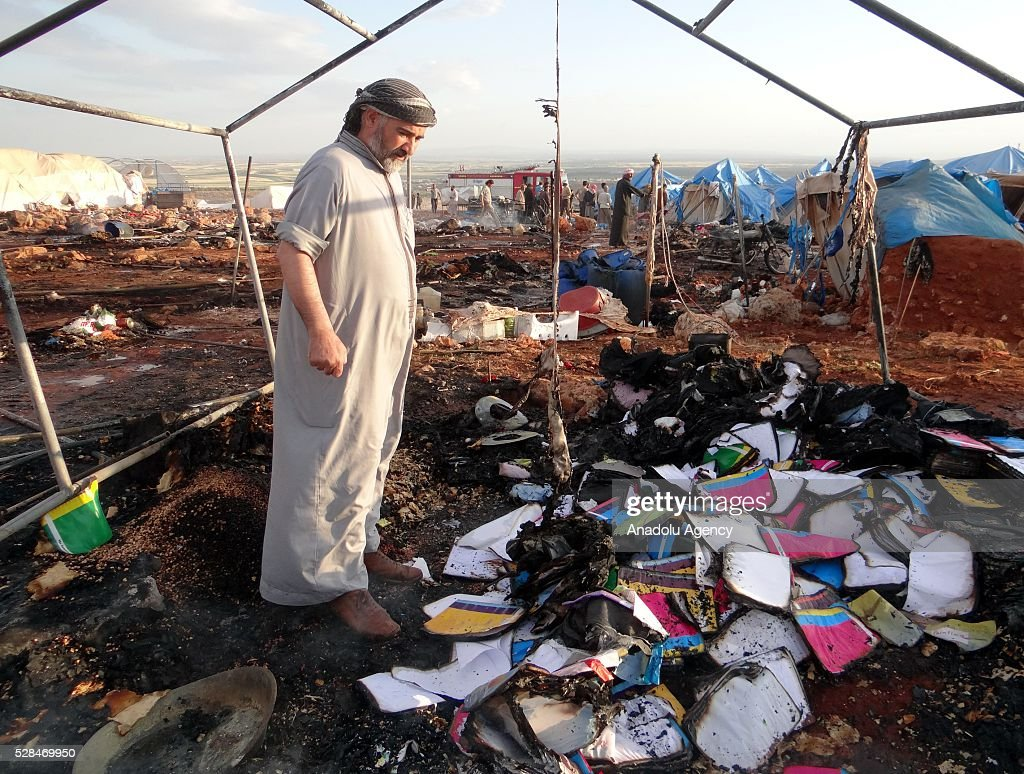 A man inspects the damage after a Syrian regime warplane targeted Kamuna refugee camp near the Syrian town of Sarmada town in the Idlib province after Syrian regime warplane targeted the camp on May 05, 2016. Eight people were killed and another 30 injured when a regime warplane targeted the Kamuna refugee camp.