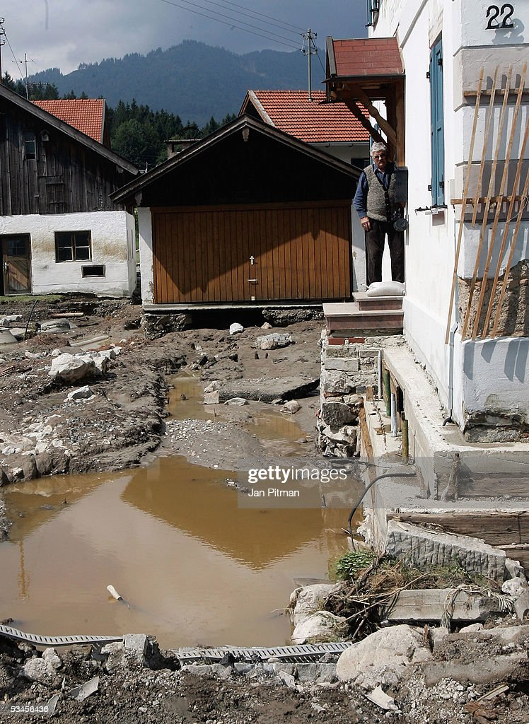 A man inspects the flood damage as he stands in the entrance of his house on August 24, 2005 in Eschenlohe, Germany. Flooding has caused thousands of people to abandon their homes in recent days, as transport links were cut, leaving many villages completely isolated. It is reported that at least 11 people are dead or missing in the floods that struck Germany, Austria and Switzerland. People in southern Bavaria are now cleaning up the streets and their homes as the water levels drop.