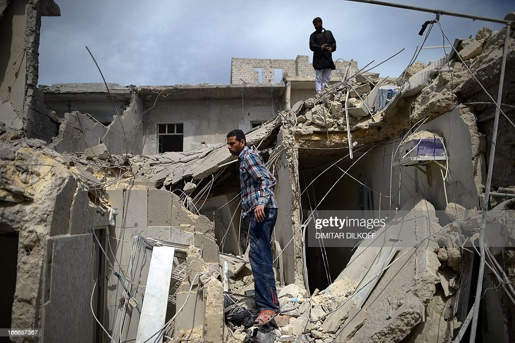 A man inspects the remains of his destroyed house following an airstrike by the Syrian airforce in the northern Syrian city of Aleppo on April 15, 2013. The conflict in Syria, which is now in its third year, has cost 70,000 lives, according to the United Nations.