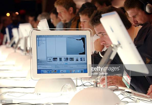A man inspects the thin screen of a new flatpannel iMac computer on display during the Macworld Conference and Convention January 8 2002 at the...