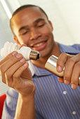 Man installing low energy light bulb