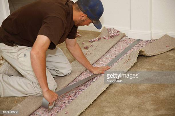 Man Installing New Carpet