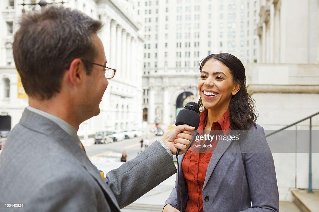 Man Interviews Smiling Woman