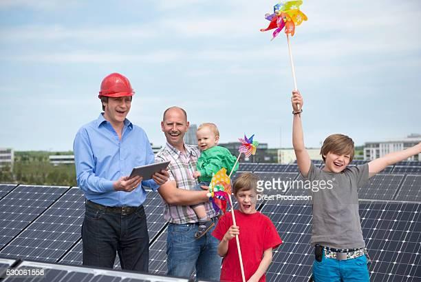 Man ipad father kids solar park
