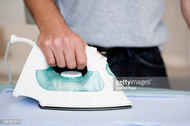 Man ironing close-up