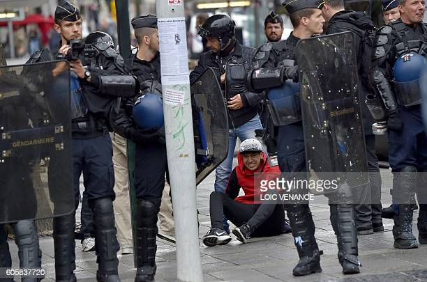 TOPSHOT A man is arrested by police officers during a demonstration against the controversial labour reforms of the French government in Nantes...