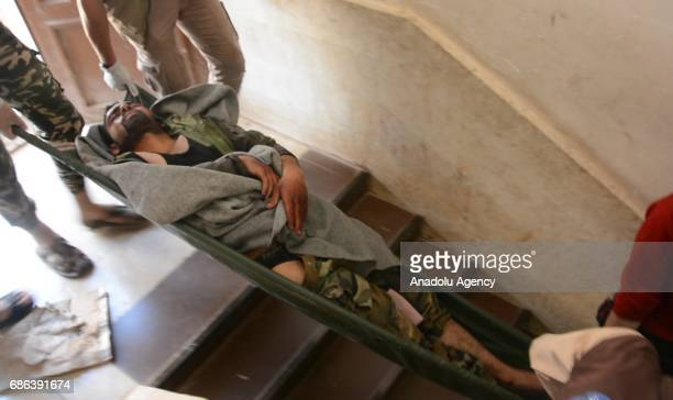 A man is being carried after a suicide attack against Ahrar alSham an armed opposition group that fights against Assad Regime at a headquarter in...