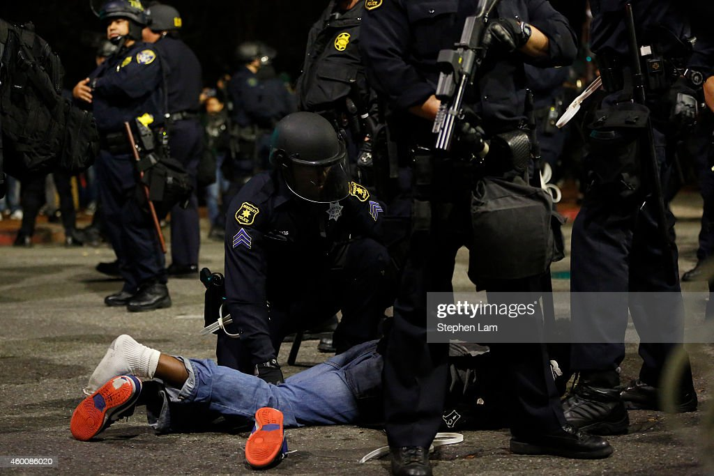 A man is being detained on the fourth night of demonstrations over recent grand jury decisions in policeinvolved deaths on December 6 2014 in...