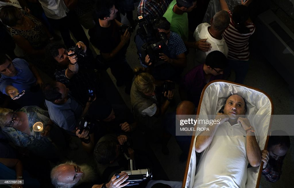 A man is carried in a coffin by his relatives during the annual 'Procession of the Shrouds' to celebrate Santa Martha 'the saint of resurrection' in...