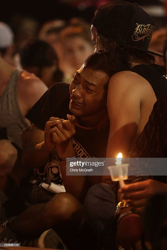 A man is consoled by a friend as he weeps at a memorial ceremony held in front of the Bali Bombing Memorial at Jalan Legian, Bali, on October 12, 2012 in Indonesia. Hundreds of foreign and local family members, friends and general public gathered at various memorial ceremonies through out the day to remember the victims of the 2002 Kuta nightclub bombings which killed 202 people, including 88 Australians.