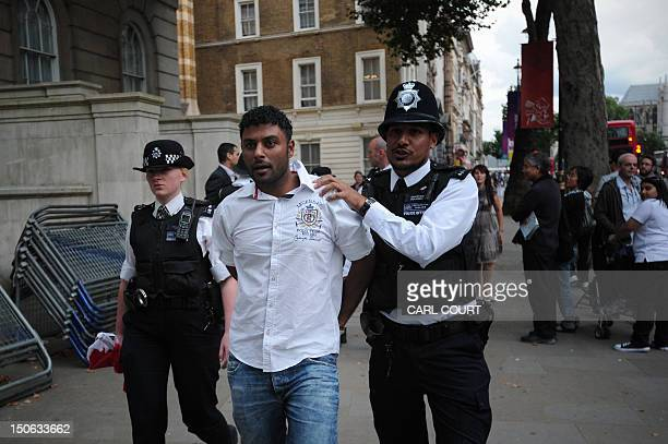 A man is detained by police during a protest outside Downing Street in central London on August 23 2012 as Bahrain's King Hamad bin Isa alKhalifa...