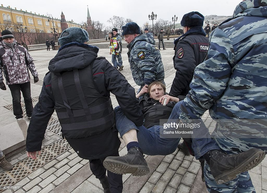 A man is detained by riot police during an unsanctioned anti-war rally close to the Kremlin at Manezhnaya Square on March 2, 2014 in Moscow, Russia, Dozens of protesters were detained by police on Sunday during a rally against the military intervention in the Ukraine, after the parliament in Moscow gave President Vladimir Putin approval to use Russian military forces in Ukraine.