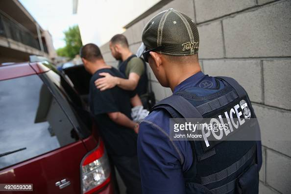 A man is detained by US Immigration and Customs Enforcement agents on October 14 2015 in Los Angeles California ICE agents said the immigrant holding...