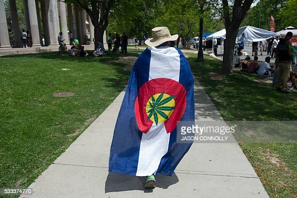 A man is draped in promarijuana colors during the Denver 420 Rally the world's largest celebration of both the legalization of cannabis and cannabis...