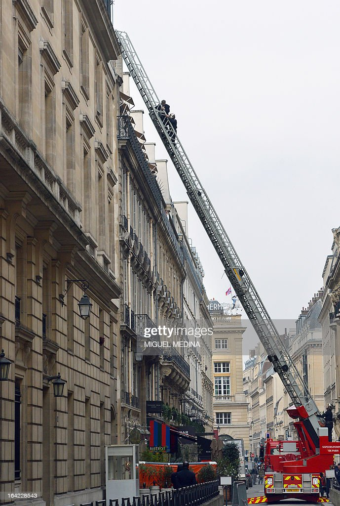 A man (Top L on the ladder) is evacuated by a fireman on March 21, 2013, after succeeding to reach the roof of the US embassy in Paris, in spite of tough security measures. The man, Herve Couasnon, 54, a bus driver from Perigueux, southwestern France, asked to have a meeting with US President Barack Obama, who is today in an official visit in Ramallah, to handle him his CV and to speak about peace. The man succeeded twice in the recent years to circumvent security measures in France.