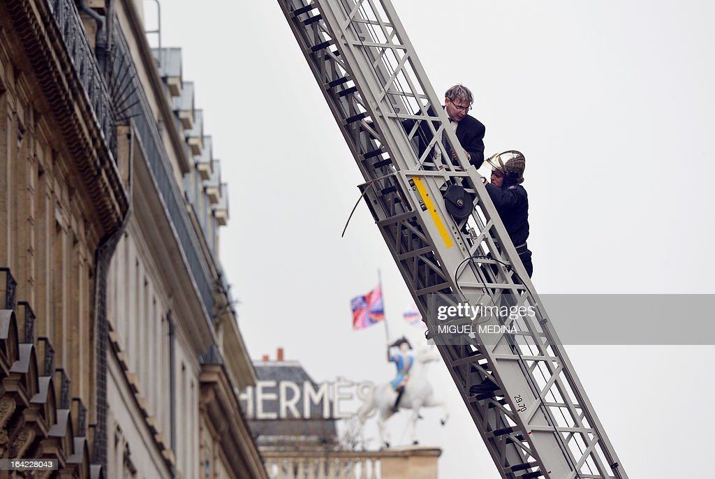 A man (C)is evacuated by firemen after succeededing to reach, on March 21, 2013, the roof of the US embassy in Paris in spite of tough security measures. The man, Herve Couasnon, 54, a bus driver from Perigueux, southwestern France, asked to have a meeting with US President Barack Obama, who is today in an official visit in Ramallah, to handle him his CV and speak about peace. The man, succeeded twice in the recent years, to circumvent security measures in France.