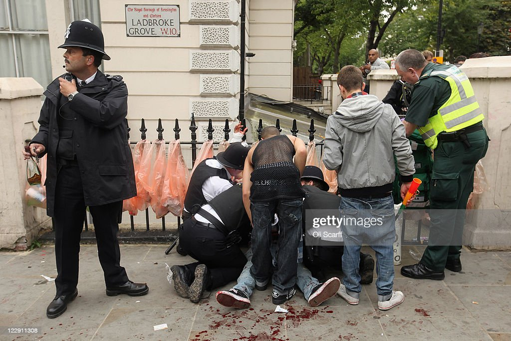 A man is given emergency medical treatment after being stabbed in the stomach at the Notting Hill Carnival on August 29, 2011 in London, England. The annual carnival, which is the largest of its kind in Europe and is expected to attract around 1 million revellers, has taken place every August Bank Holiday since 1966.