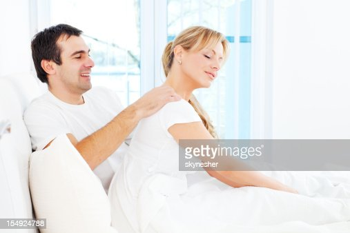 Man Is Giving A Massage To His Wife In Bedroom Stock Photo   Getty Images. Man Is Giving A Massage To His Wife In Bedroom Stock Photo   Getty