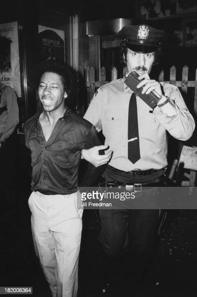 A man is handcuffed and arrested in New York City 1980