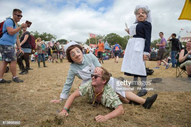 A man is held down by performers in the Theater area at Glastonbury Festival Worthy Farm Somerset PRESS ASSOCIATION Photo Picture date Sunday June...