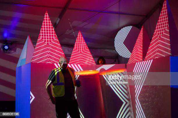 A man is illuminated in the Art Studios tent as music fans camp out at the Empire Polo Club on the eve of the 2017 Coachella Valley Music And Arts...