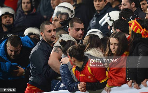 A man is injured after fighting amongst Montenegran fans during the FIFA 2014 World Cup Group H Qualifier between Montenegro and England at City...
