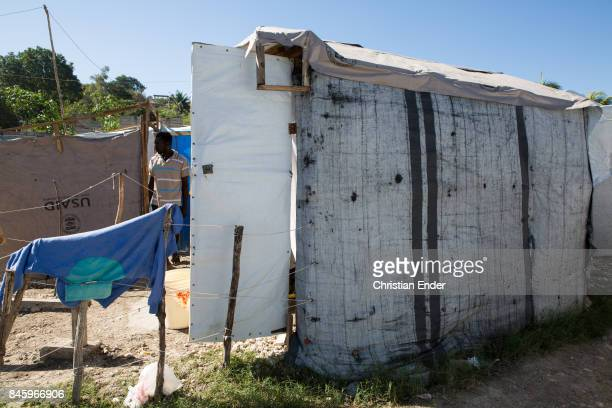 PortauPrince Haiti December 09 2012 A man is leaving his shack in the refugee camp Parc Colofe in PortauPrince The camp exist since the devastating...