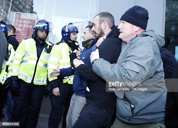 A man is led away by two plain clothes police officers in London Wall London during the latest student fees march