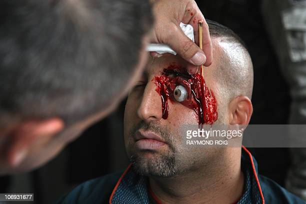 A man is made up prior to a rescue operation training in the high speed tracks tunnel linking France and Spain across the Pyrenees mountains on...