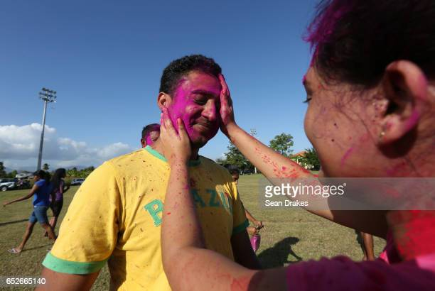 A man is painted with colorful abeer powder to commemorate Holi and the arrival of the season of Spring as part of the annual Phagwah ceremony at...