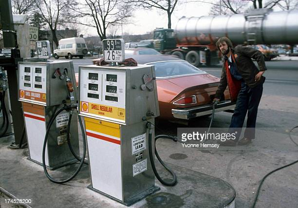A man is photographed pumping gas on his car February 23 1983 at a Shell gas station on Route 4 in Paramus New Jersey Gasoline prices have taken a...