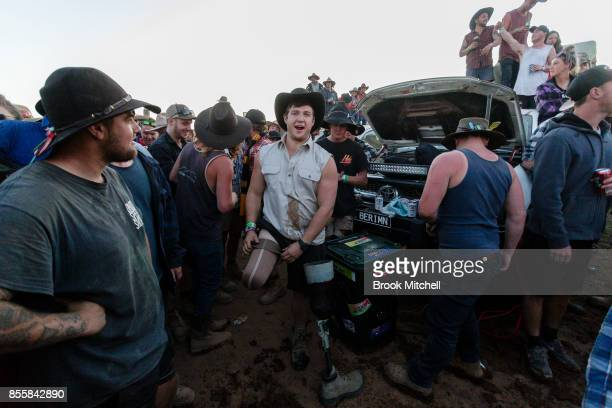A man is pictured after drinking beer from his artificial leg on the final evening of the 2017 Deni Ute Muster on September 30 2017 in Deniliquin...