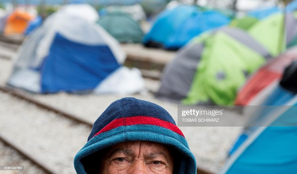 A man is pictured at a makeshift camp for migrants and refugees near the village of Idomeni not far from the Greek-Macedonian border on May 4, 2016. Some 54,000 people, many of them fleeing the war in Syria, have been stranded on Greek territory since the closure of the migrant route through the Balkans in February. / AFP / TOBIAS